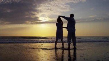 couple dancing on beach