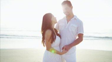 couple enjoying holiday on the beach
