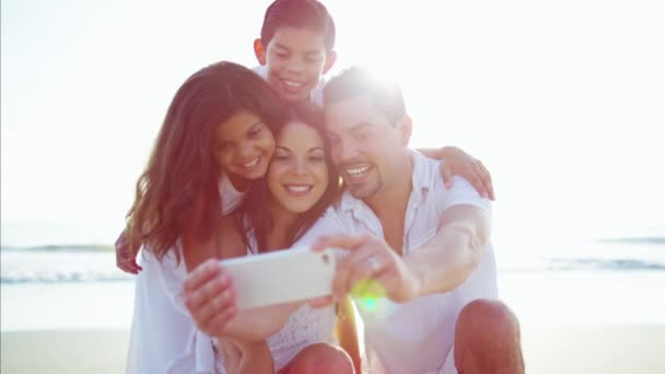 family using smartphone
