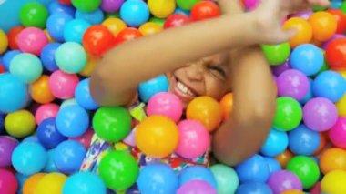Child in alls in big paddling pool