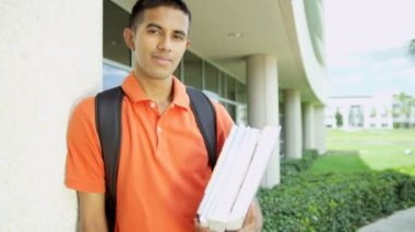 teenager carrying library books