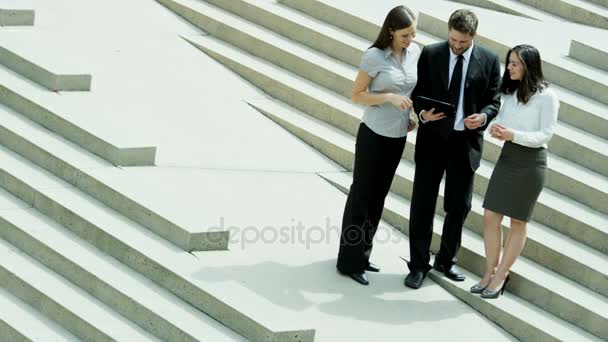 colleagues using tablet