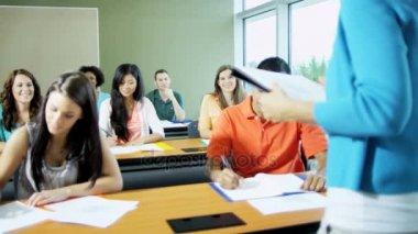 Teenagers sitting in classroom
