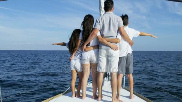 family sailing on yacht