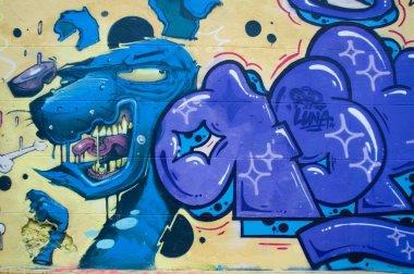 facade with colorful graffiti
