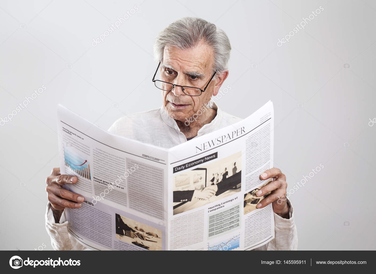 portrait elderly man reading newspaper — stock photo © seb_ra #145595911