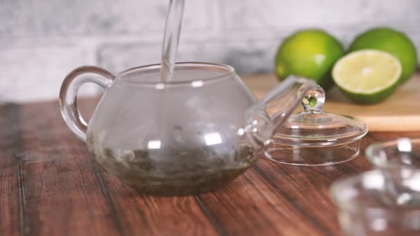 The tea leaves are brew in boiling water and infuse in a small teapot. The concept of the tea party. Green tea in a teapot