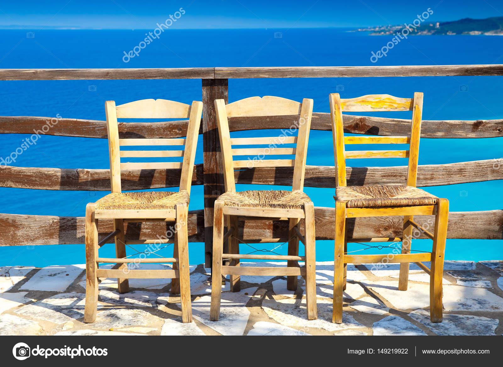 Three Cane Seat Chairs At Greek Cafe Near Blue Sea U2014 Stock Photo