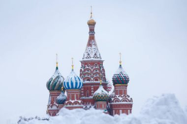 MOSCOW - FEBRUARY 04, 2018: Saint Basil's Cathedral domes after great winter snowfall, Moscow, Russia