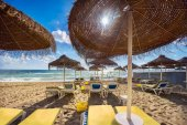 Fotografie Beach with umbrellas and sunbeds at Benalmadena beach