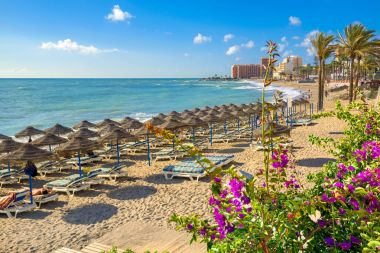 Beach with umbrellas and sunbeds at Benalmadena beach