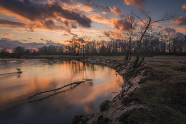 Sunset over the Pilica river near Mniszew, Poland