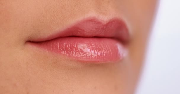Macro shoot of a mouth covered with lip gloss
