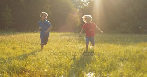 Two happy kids run competition over field in sunshine