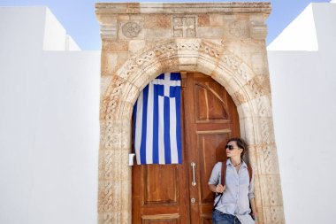 young woman traveler in the Greek city