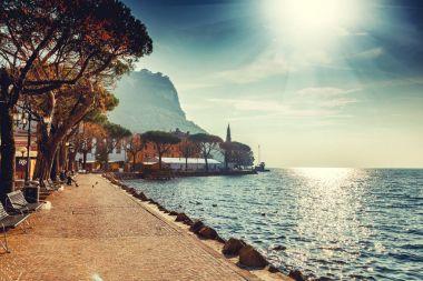 Beautiful landscape, small city on Garda lake, Italy. Popular tr