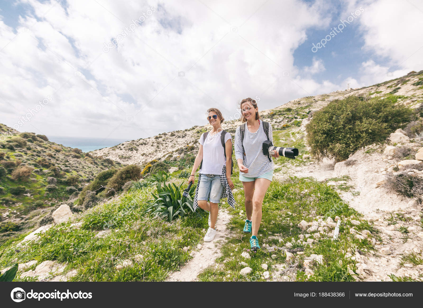 two happy attractive young girls traveling together 846244044317e