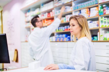 Two pharmacists working in a drugstore.