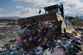 Photo Garbage truck unloading waste on landfill, environmental concept.