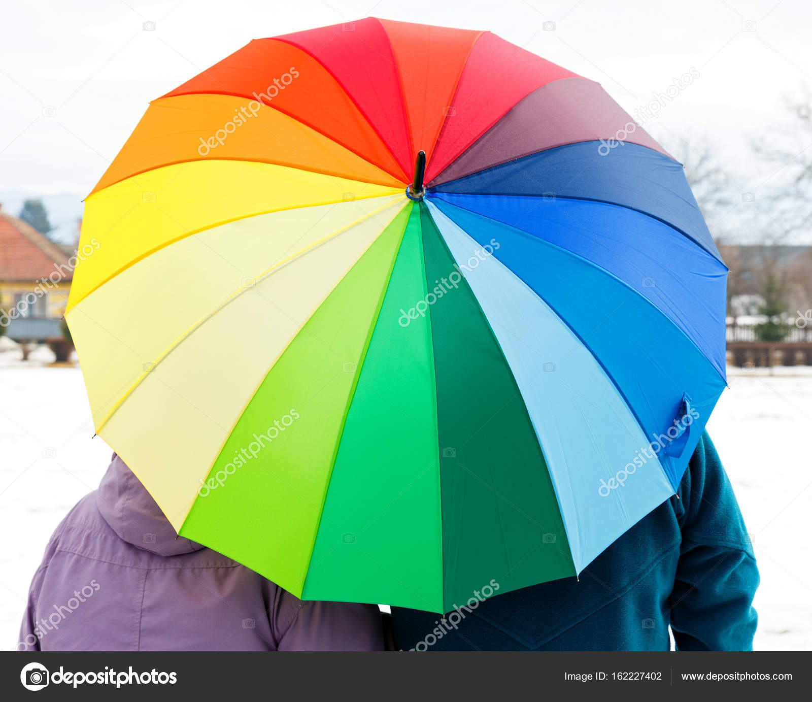 Elderly couple with colorful umbrella — Stock Photo © obencem #162227402