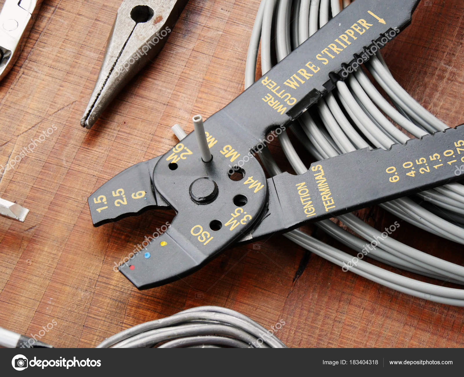 Cutting electric cable with wire cutter — Stock Photo © Whiteaster ...