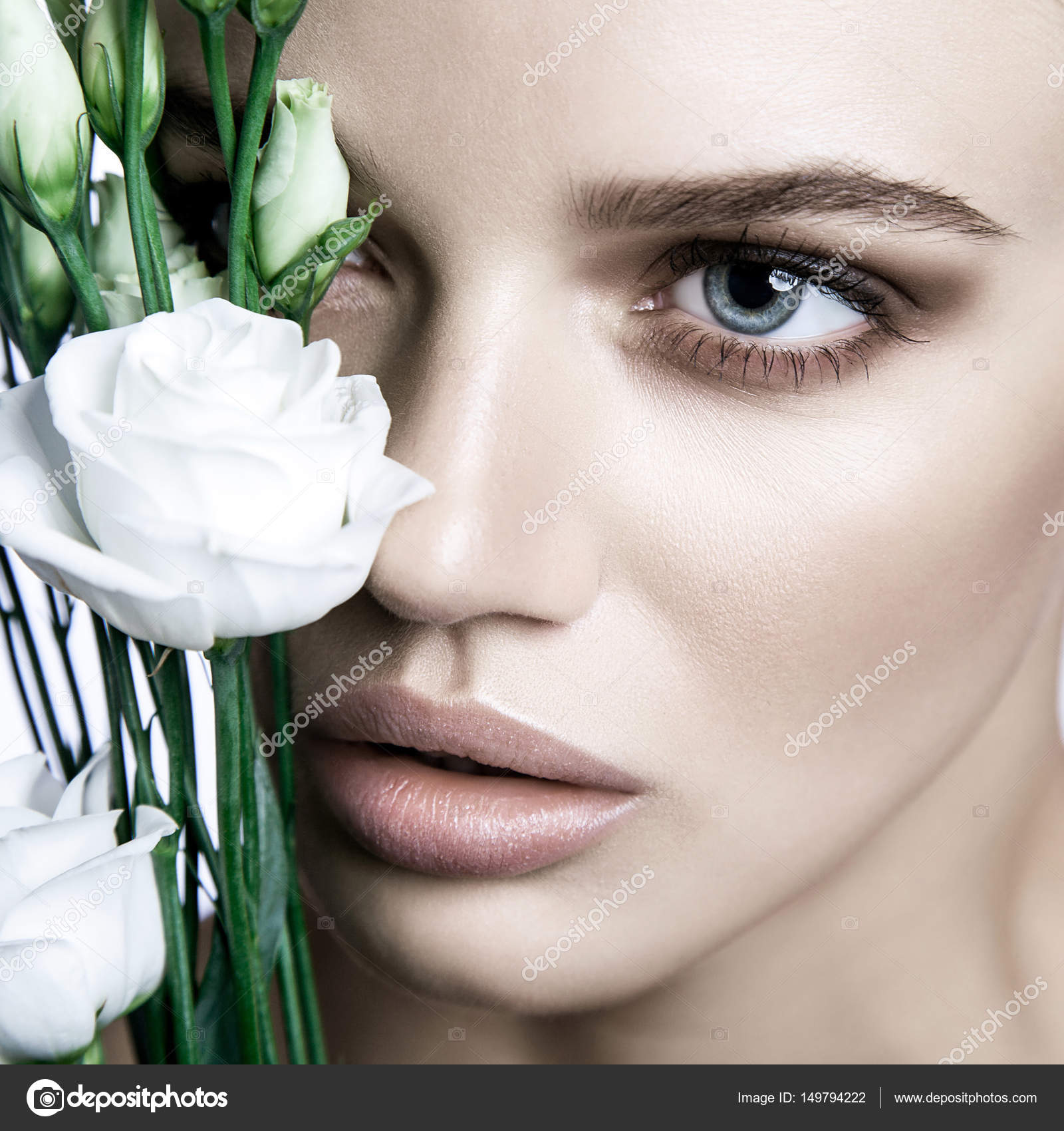 Calm beauty fashion model woman face portrait with white rose calm beauty fashion model woman face portrait with white rose flower beautiful blonde woman with blue eyes and nude makeup studio shot izmirmasajfo
