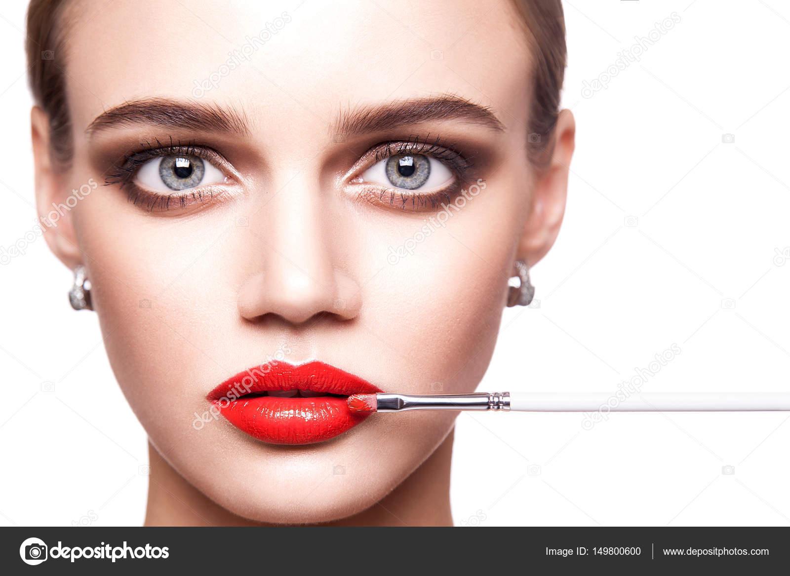Professional Makeup Artist Applies Makeup For Beautiful Young Woman