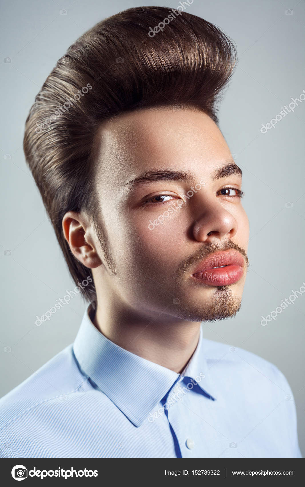 Portrait of young man with retro classic pompadour hairstyle. studio ...