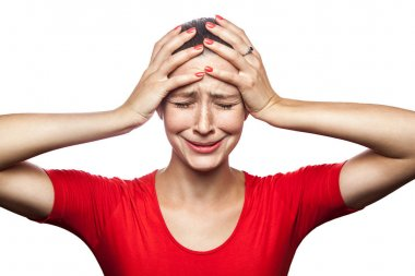 Portrait of sad unhappy crying woman in red t-shirt with freckles. closed eyes hands on head, studio shot. isolated on white background. stock vector