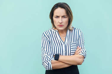 Angry, aggressive. Handsome adult elegant woman looking at camer