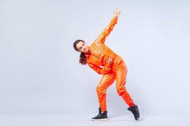 Full length portrait of positive energetic teen girl dancing hip