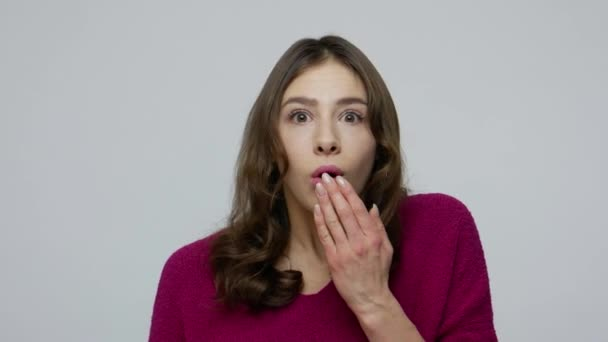 Wow, unbelievable! Astonished amazed brunette woman in pullover covering mouth with hand