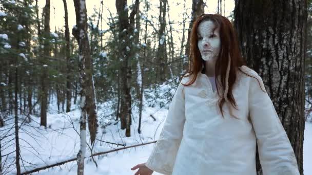 Mystical shaman healer in winter forest