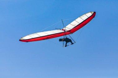 Hang glider flight against the blue sky