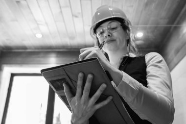 Construction inspector woman takes notes