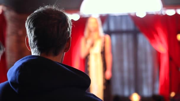 Young man sharing thoughts to woman on stage