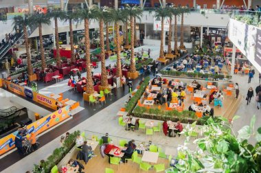 KRASNOYARSK, KRASNOYARSK TERRITORY, RF - March 18, 2017: People eat in the cafeteria on the ground floor in the shopping and entertainment center