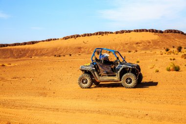 Merzouga, Morocco - Feb 26, 2016: Side view on blue Polaris RZR