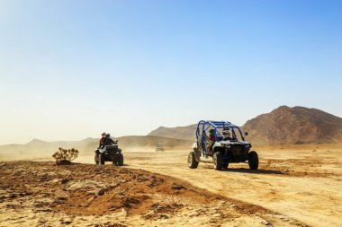 Merzouga, Morocco - Feb 24, 2016: convoy of off-road vehicles (R