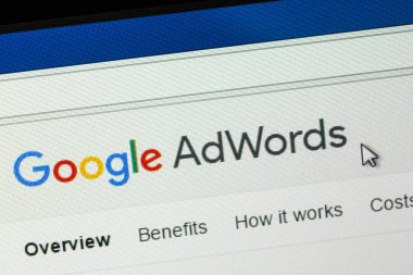 Paris, France - January 03, 2017 : Google AdWords is an online advertising service that enables advertisers to compete to display brief advertising copy to web users, based on keywords.