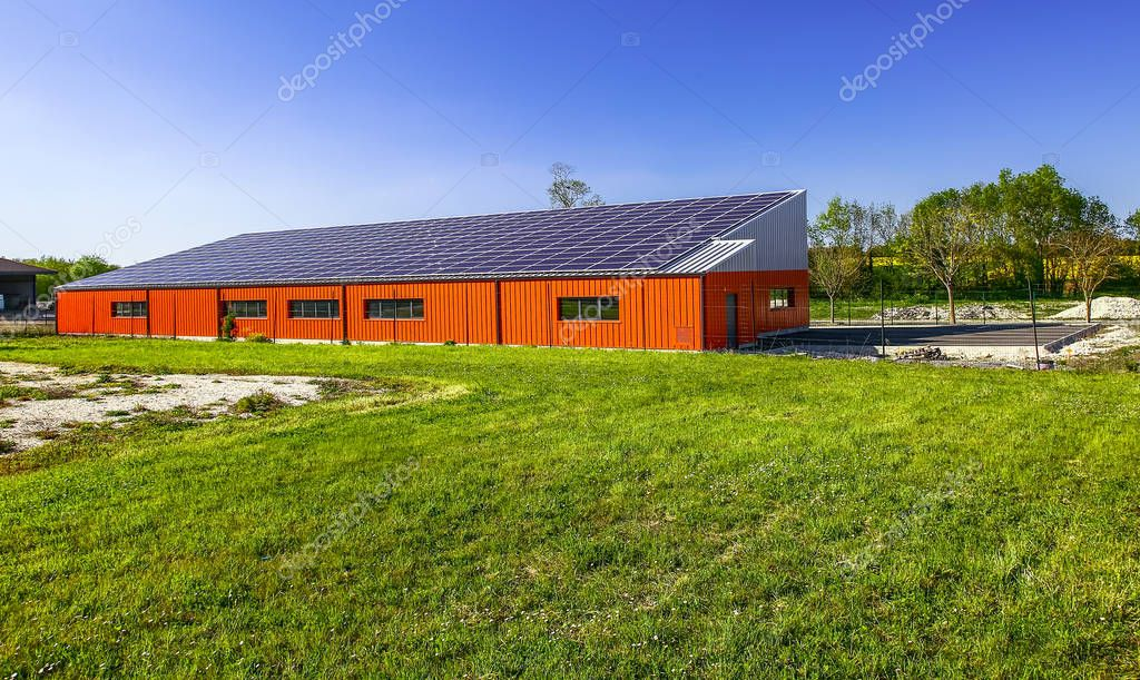 Surgeres, France - April 09, 2017:Solar panel on a roof of commercial warehouse