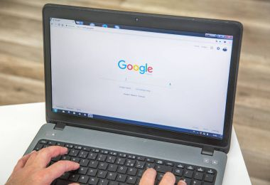 Paris, France - January 27, 2017 : Man using a laptop and performing a search on the search engine google france
