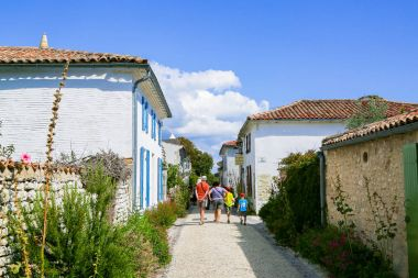 Tourists in a village classified among the most beautiful one in France.