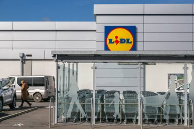 Cognac, France - February 21, 2020:Lidl supermarket shopping trolleys on a parking lot deserted by customers
