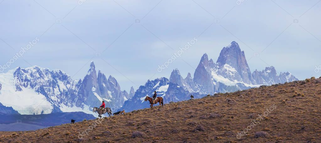 Gaucho riding against the background of Mount Fitz Roy, Patagoni