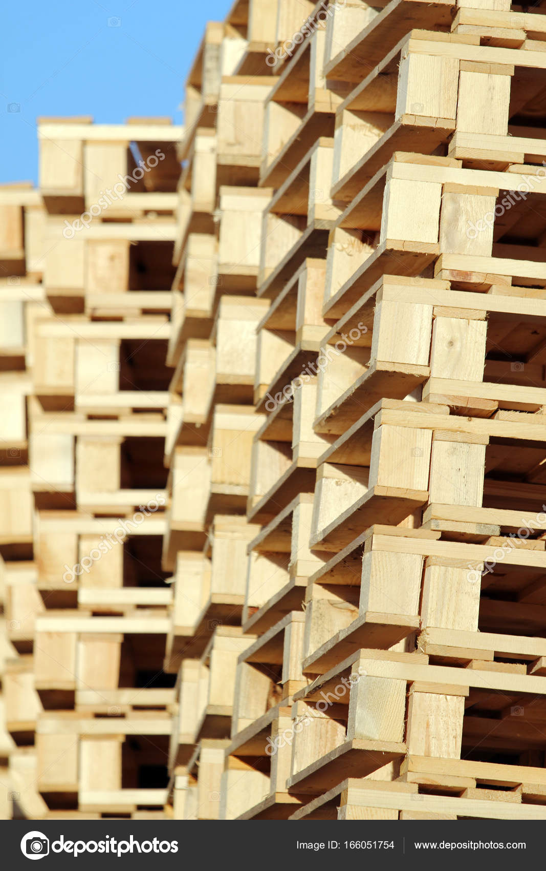 Stacked wooden pallet under blue sky — Stock Photo © kodda #166051754
