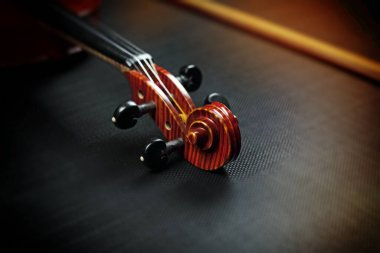 Blurred Scroll of violin put on background,vintage and art tone,blurry light around