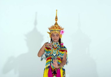 The beautiful woman wearing Thai Tradition southern costume and put headdress on her head,standing on white background,folk dance,black shadow reflection on white background stock vector