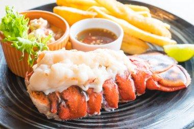 Lobster steak in black plate