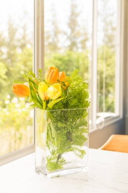Plastic or fake flower in vase on table for decoration
